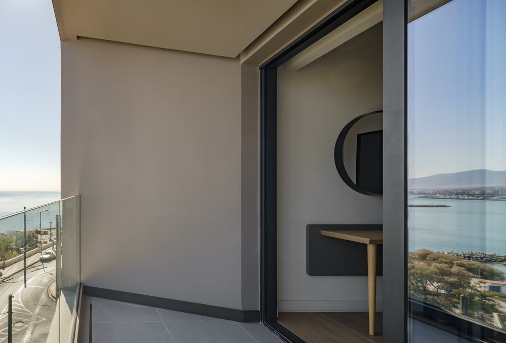 Open window and balcony view to the sea