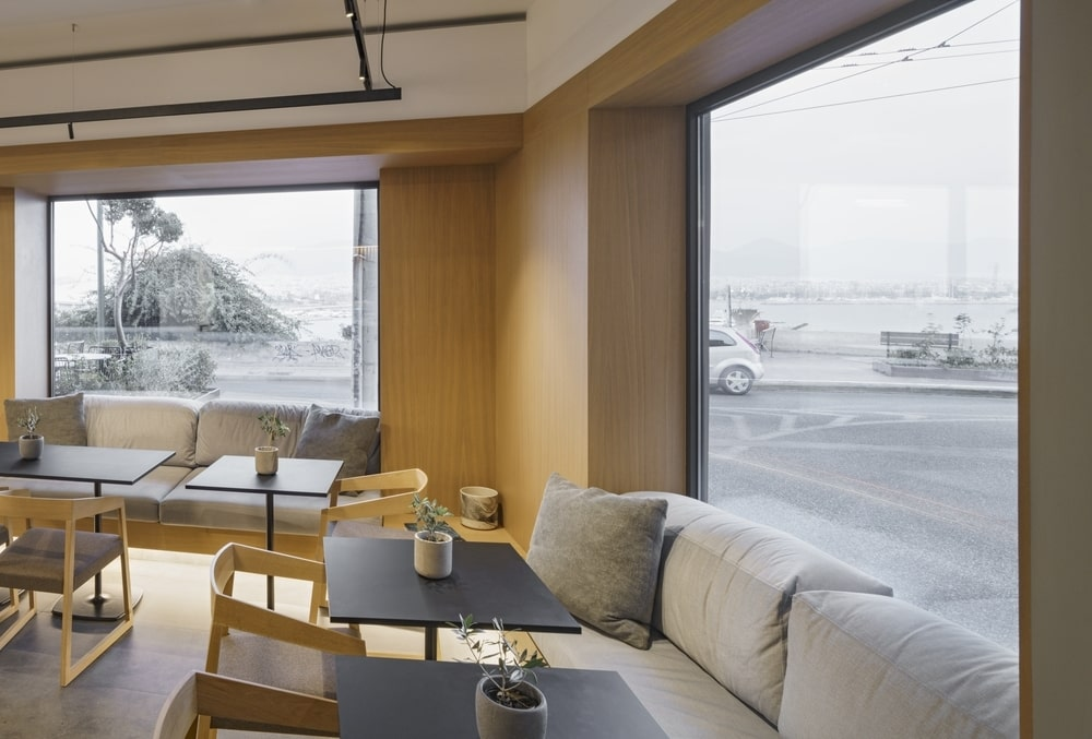 Sitting area with sofas, chairs and tables by the window