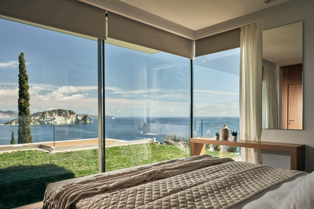 View to the sea from the bed, through the aluminum window