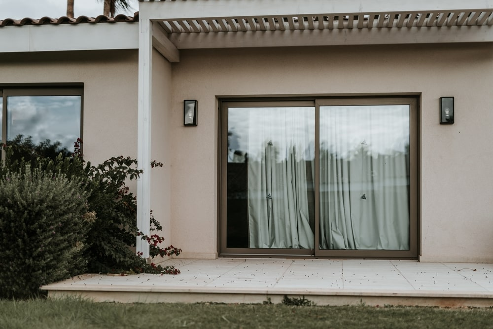 Closed aluminum window and outdoor terrace