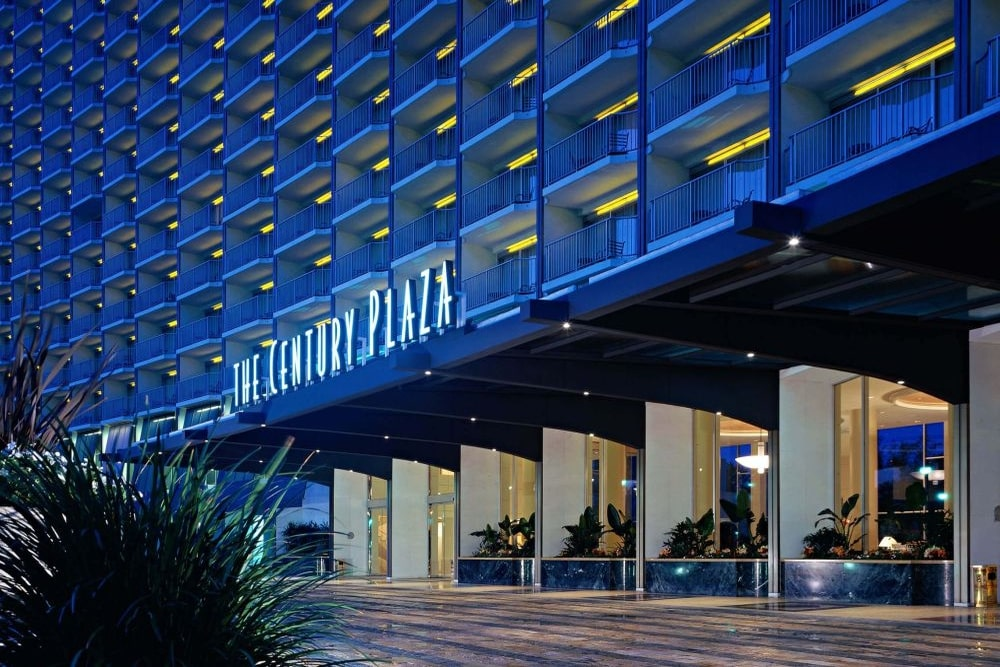 The hotel's entrance at night