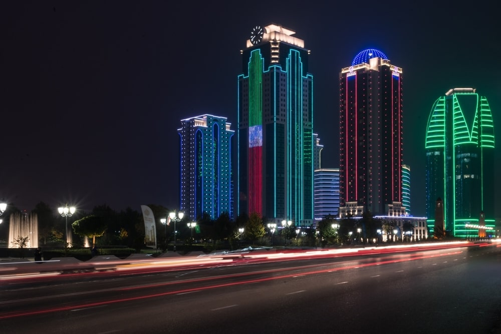 The buildings with lights on