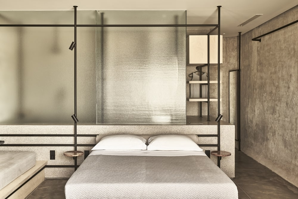 Bed with nightstands and a glass partition in the back