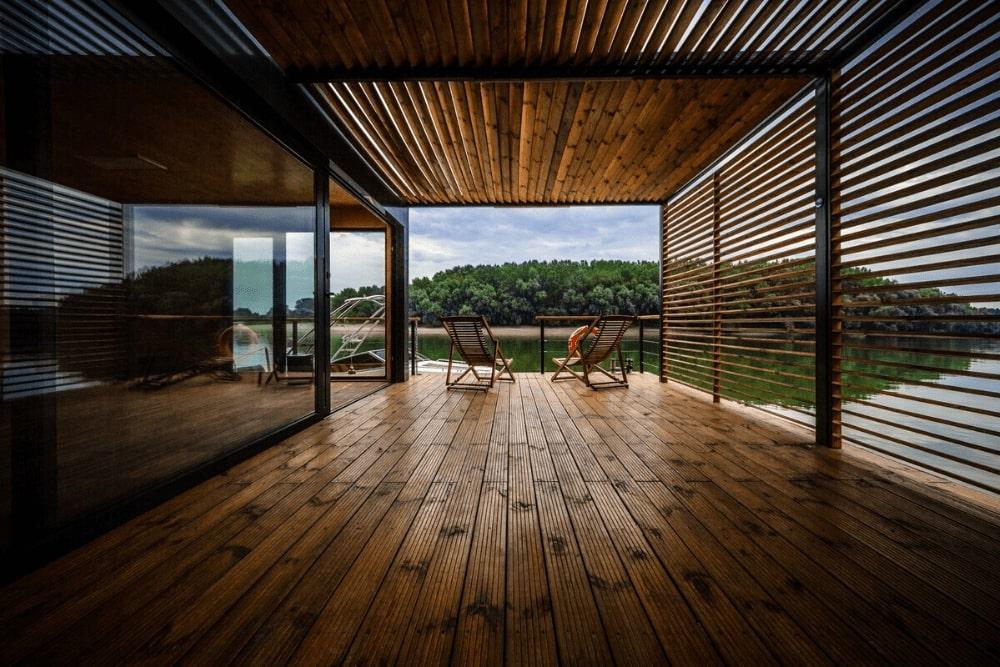 Enclosed terrace with pergola and open aluminum window