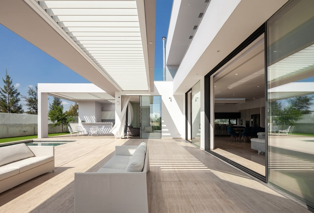 Terrace with sitting areas next to the living room open aluminum windows
