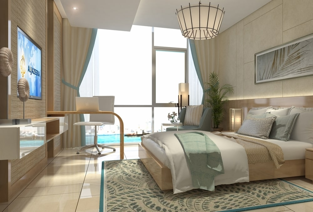 Large bedroom in beige tones with glass openings