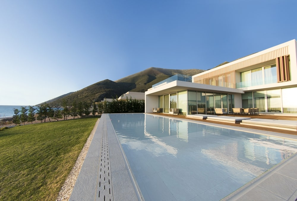 The house has a large terrace with a pool, overseeing the garden