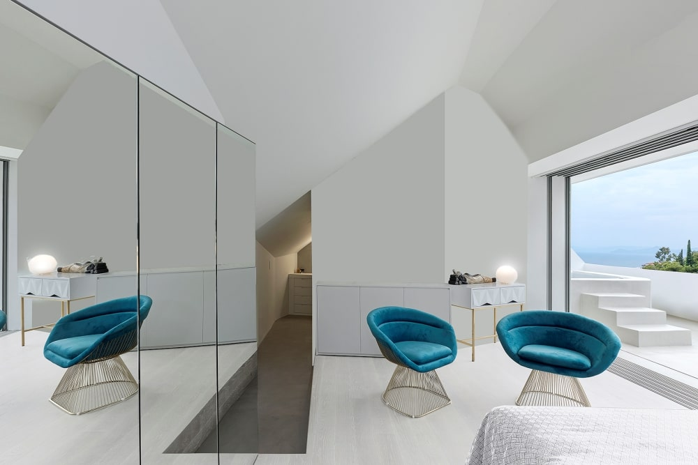 Room with two stylish chairs and mirror