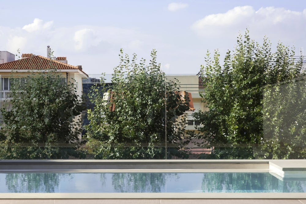 The pool overlooks some trees