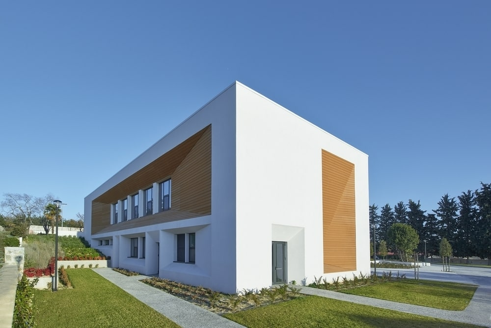 White building with brown cladding