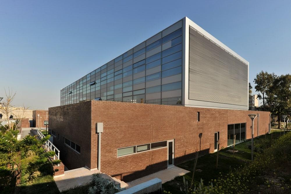 Brick wall and glass façade