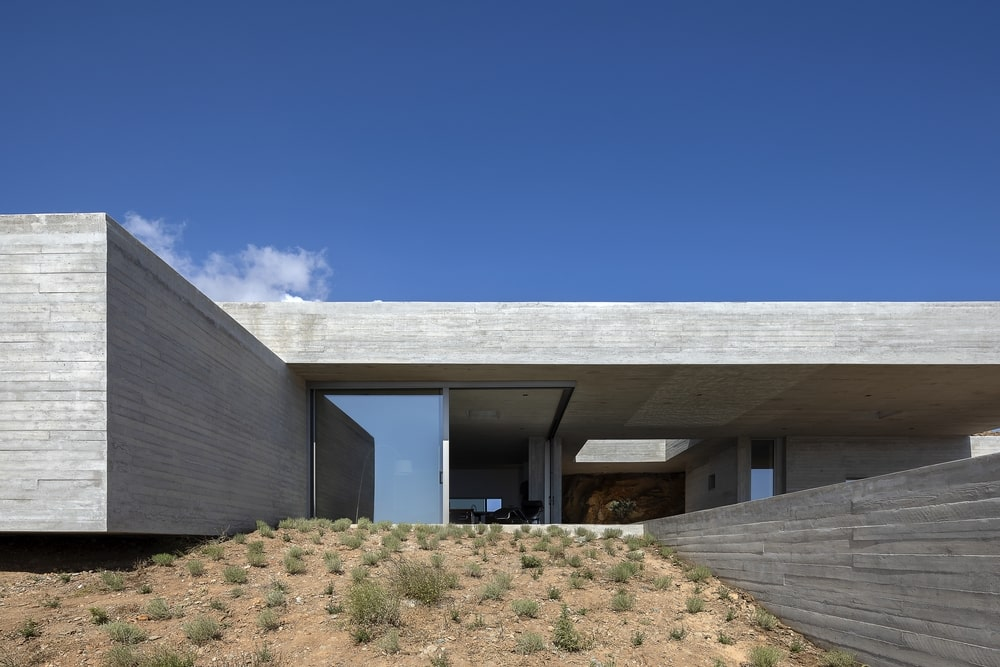 House made of concrete, corner window open