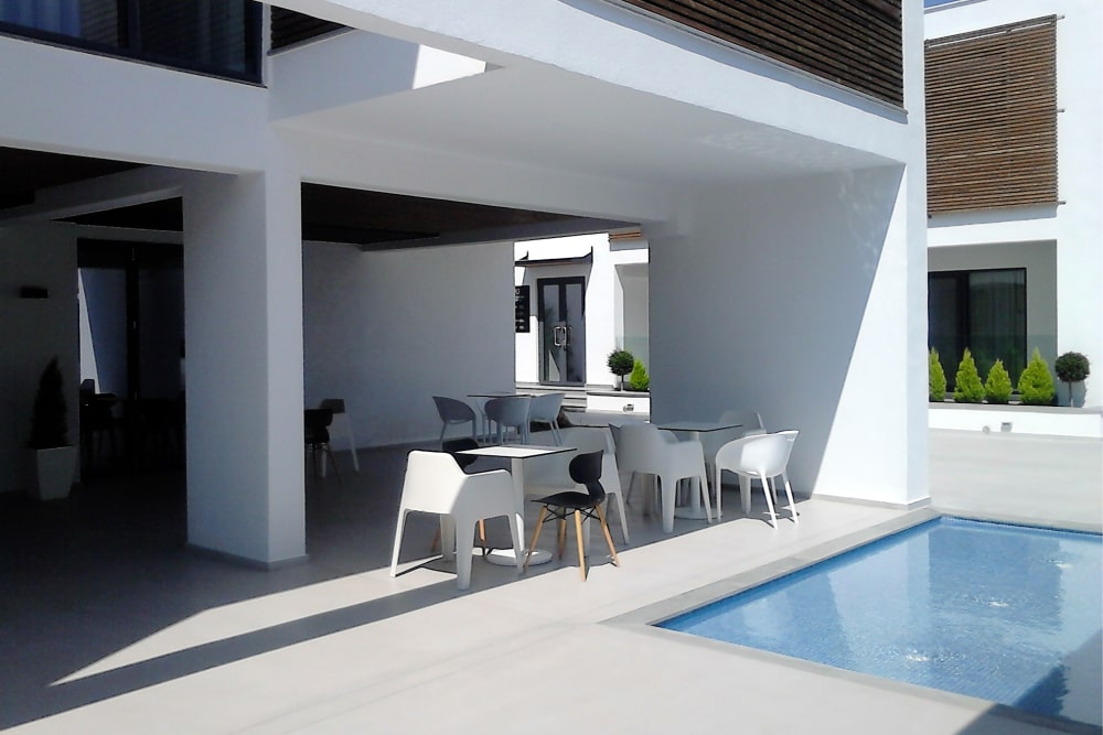 Terrace with tables and pool