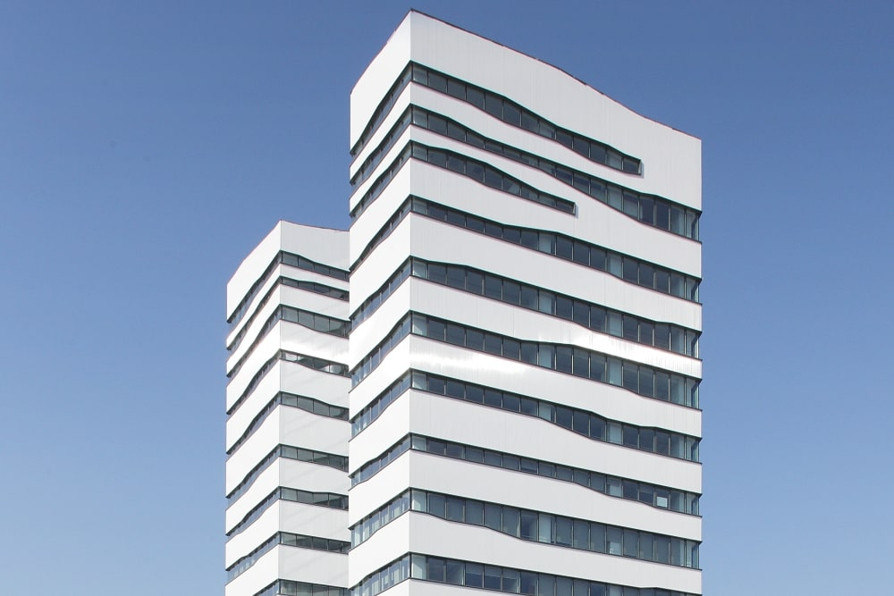 The building is white with glass facades