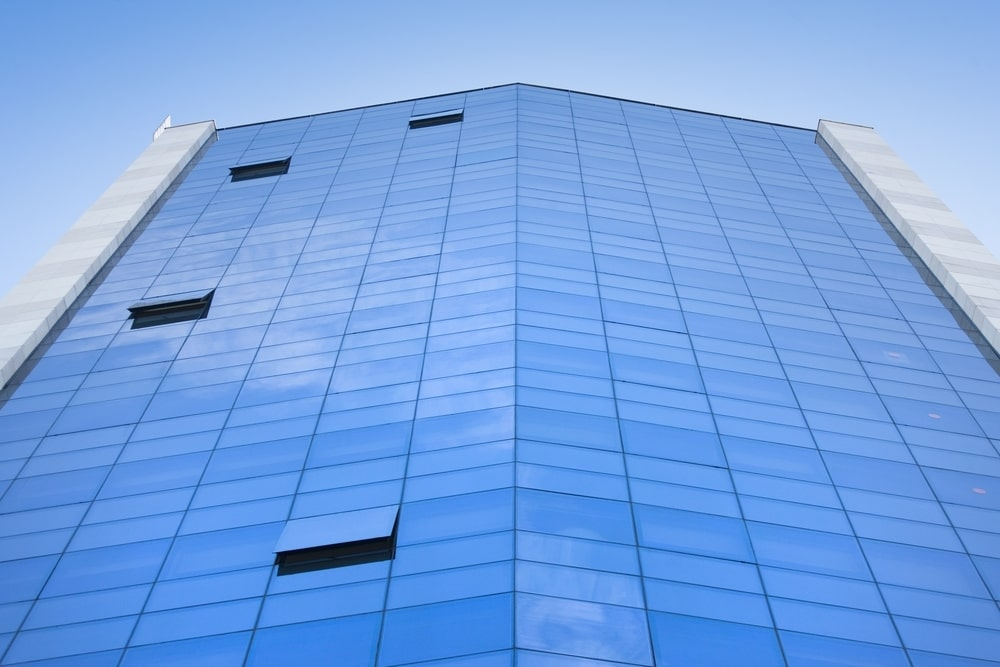 The building is covered with a curtain wall