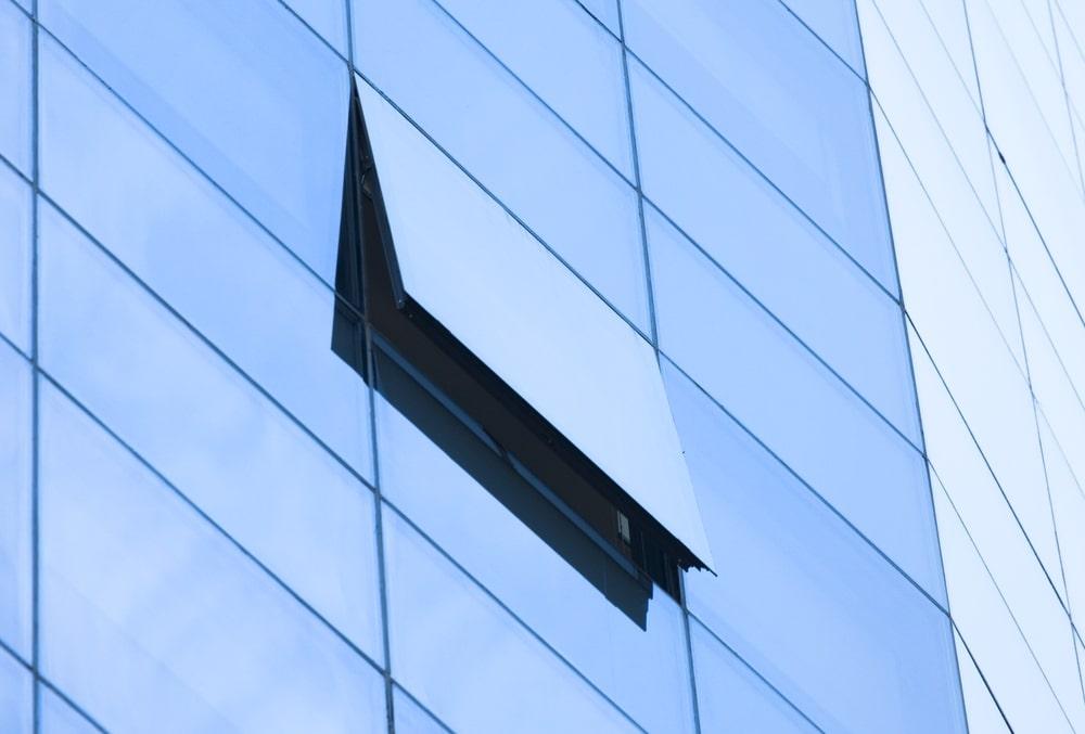 An open window on the glass façade