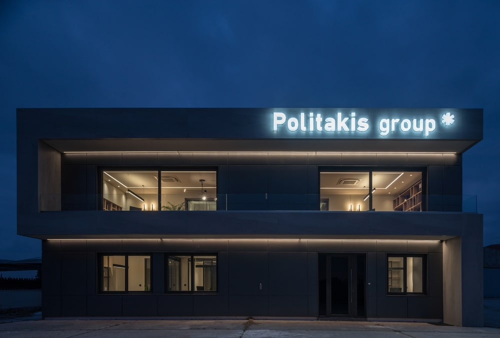 Two-storey building at night with large sign lighted up