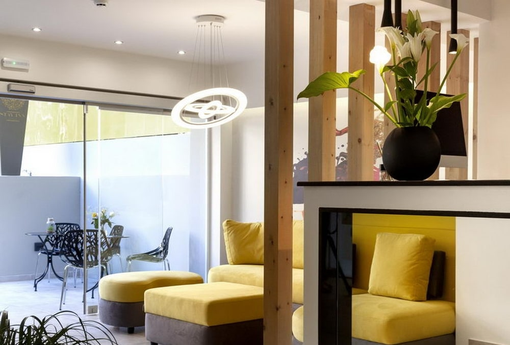 The lobby with a yellow sofa and wooden details