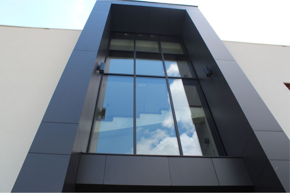 The glass façade in the front of the building