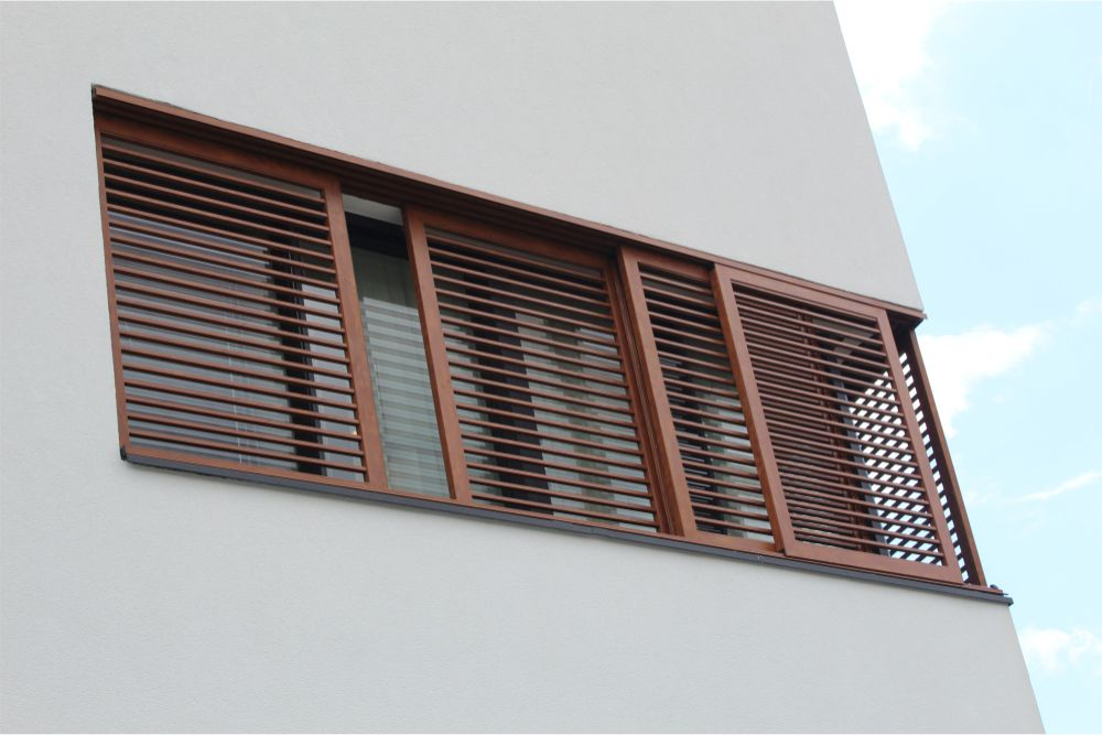 Aluminum windows with brown shutters