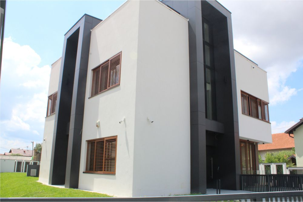 The white villa with the dark and brown details