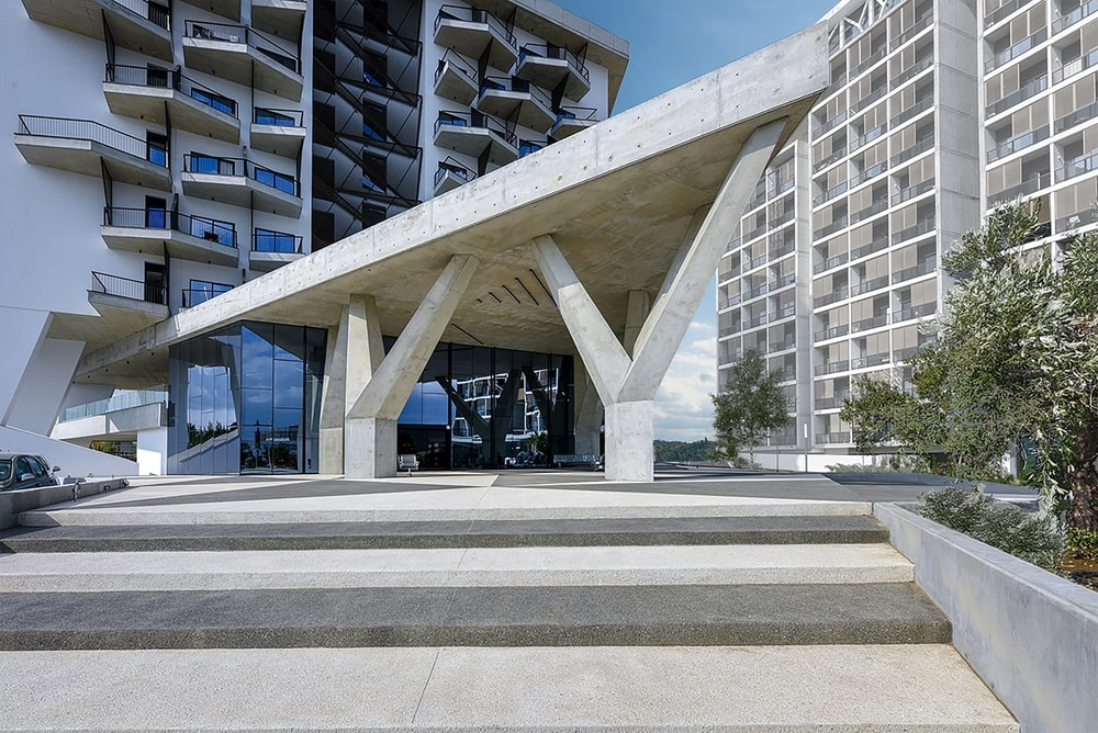Entrance of the building with a large triangle made of concrete