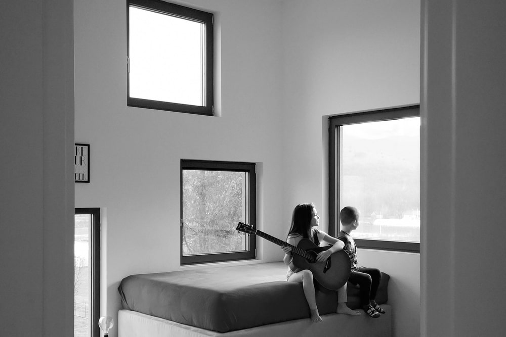 The bedroom has many square windows