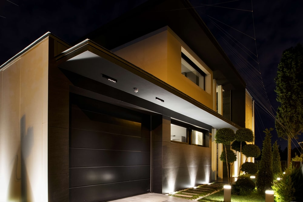 Close up to the house and the garage at night