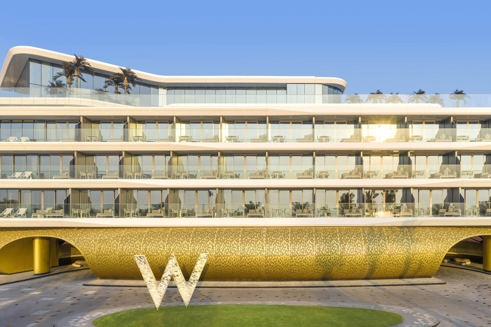 The large W sign in front of the building