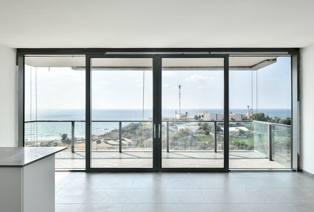 Closed aluminum windows with a view to the sea